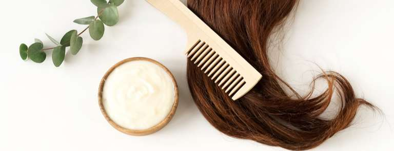 hair mask with wooden comb and green leaves and brunette hair