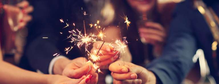 friends with sparklers celebrating