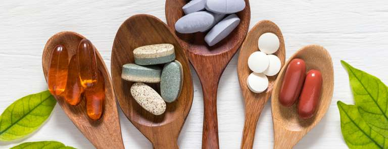 wooden spoons with different supplements