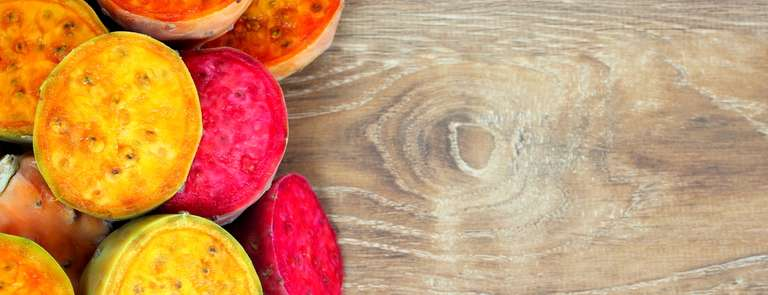 inside of the prickly pears on a wooden surface