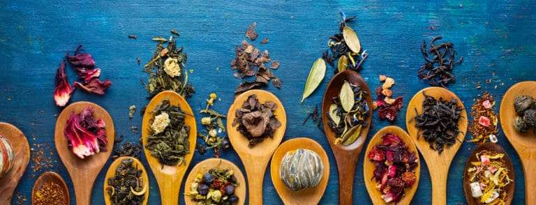 Various wooden spoons with ingredients on them