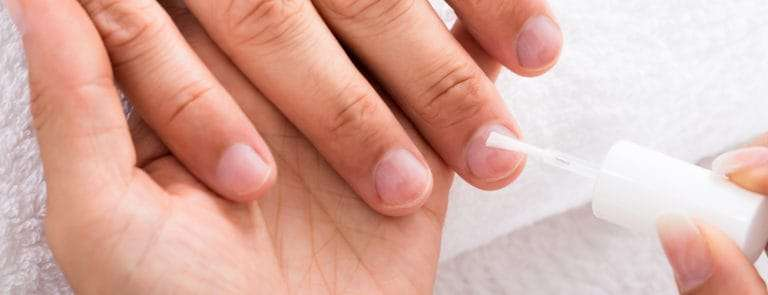 nails being painted clear