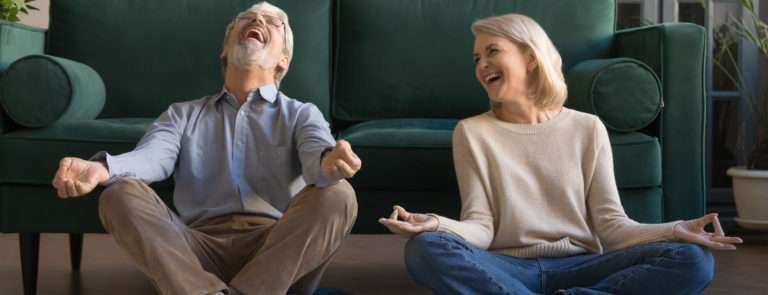 couples doing laughter yoga