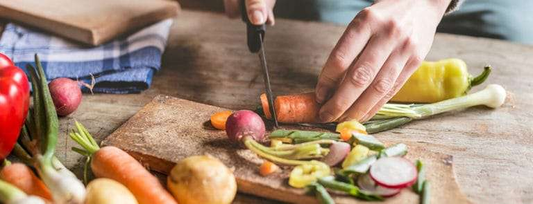 Chopping vegetables with knife