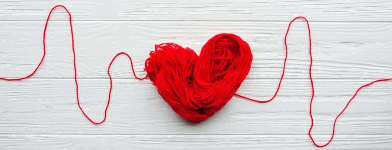 Abstract red heart. Problems with heart. Heart and cardiogram is made of red thread.