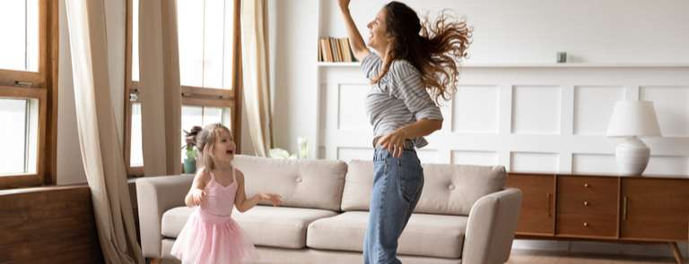 woman and child dancing around the sitting room