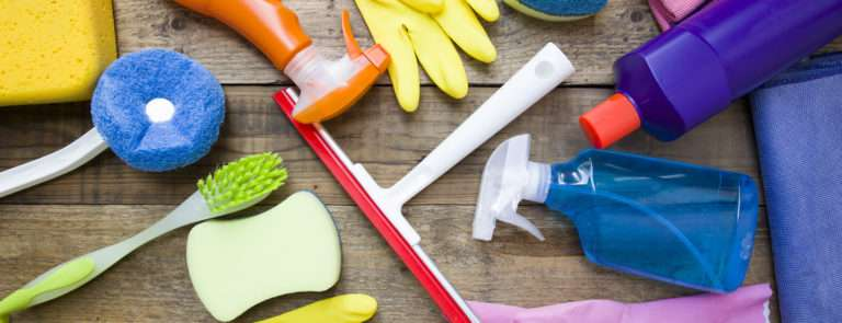 A variety of cleaning products and utensils scattered around.