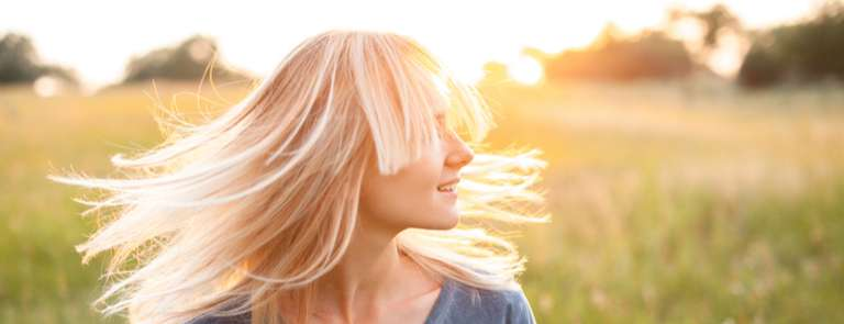 woman with light blond hair in sun