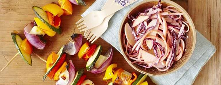Halloumi and vegetable kebabs with fruit coleslaw