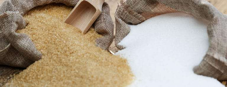 Bags of brown and white sugar