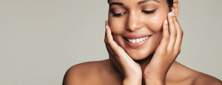 woman with healthy skin smiling