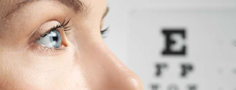 young woman's eye at eye test