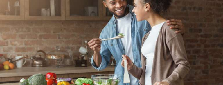 couple cooking and eating together