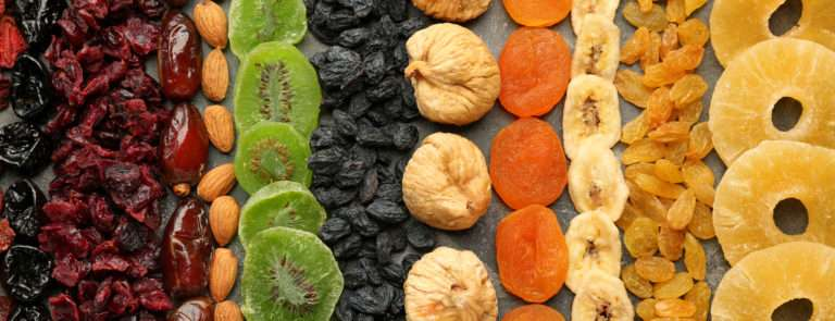 An array of dried fruits, spread out into lines going vertically down the image.