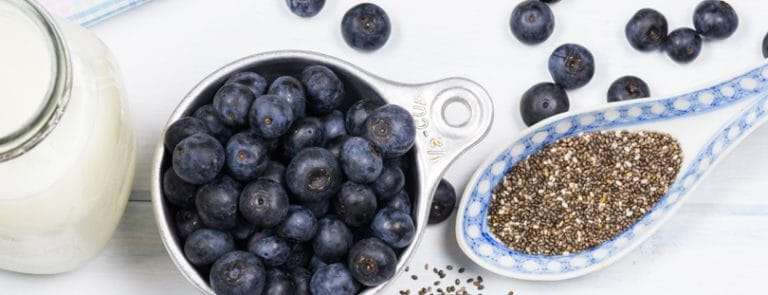 A Spoon of Chai Seeds And Blueberries and Milk
