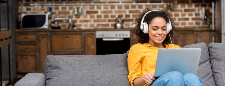 woman listening to music while working to increase productivity