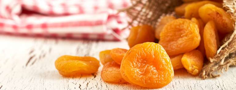 dried apricots in rustic bag