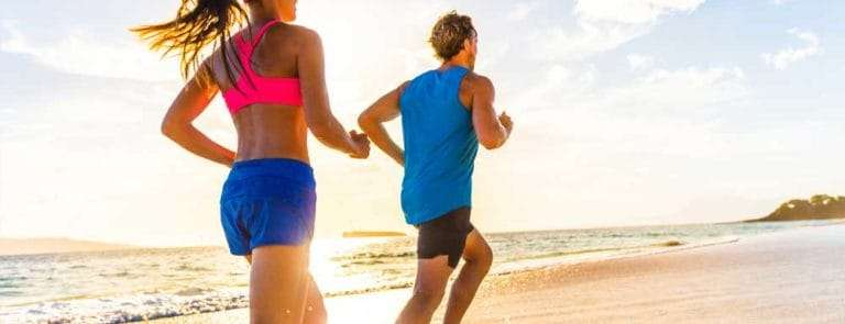 Man and woman running on a beach