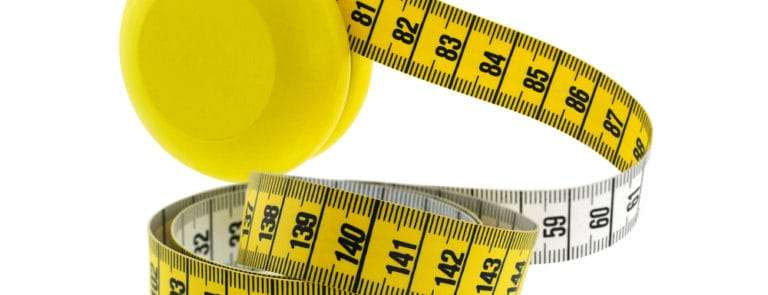A yellow and white tape measure