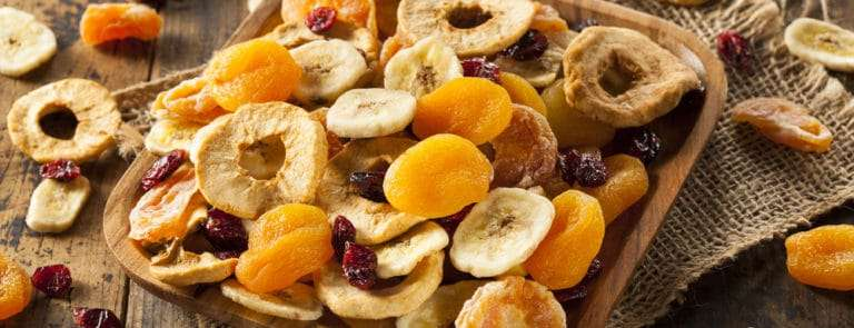 Mixture of dried fruit on wooden table
