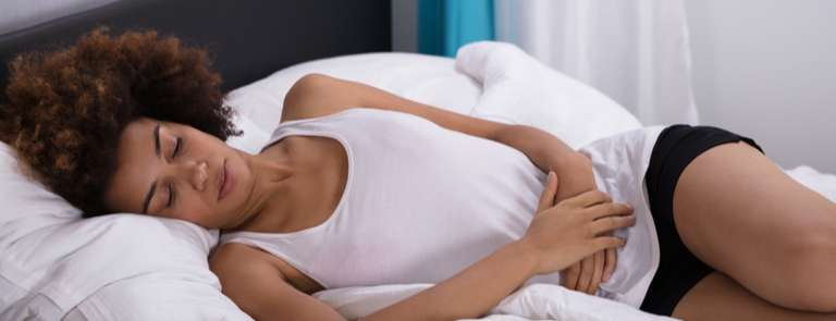 woman experiencing stomach cramps