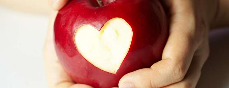 apple with heart shape cut out of it