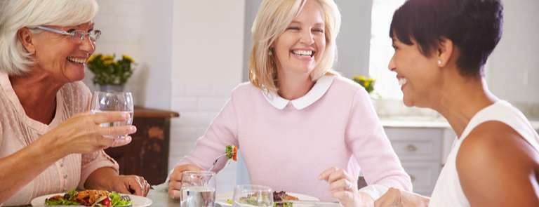 group of mature menopausal women eating a healthy meal to balance sugar levels