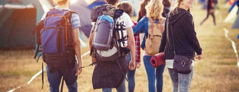 Group of teens arriving at summer festival
