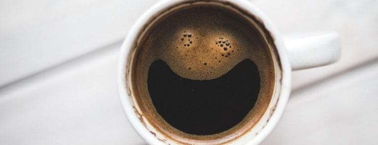 Coffee cup with a smile on the surface