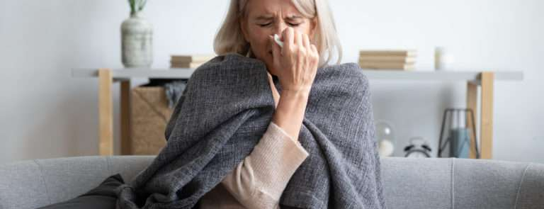 woman with symptoms of a weak immune system