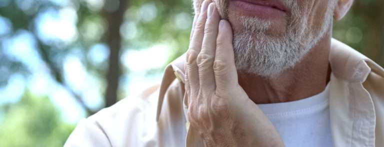 man with bruxism jaw pain