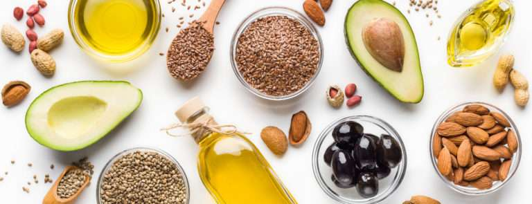 A selection of keto diet foods including avocado, nuts and oils