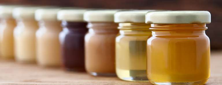 different varieties and colours of honey jars