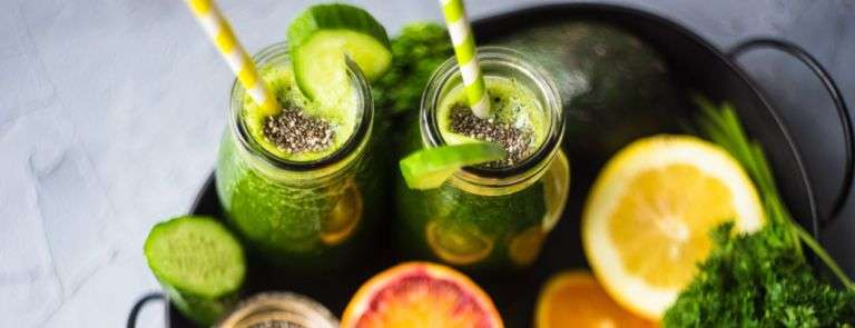 Smoothies, vegetables and fruit on a metal tray